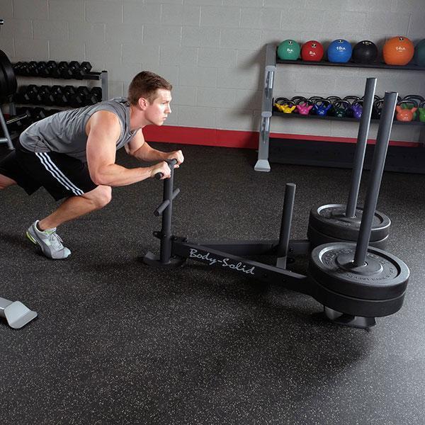 Pulling sled garage gym guy